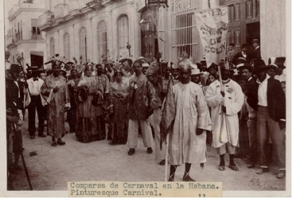 Multiracial Carnival Band Los Chinos de Colón, Havana, (1919). In The Chinese in Cuba, 1847-Now, Mauro García Triana and Pedro Eng write: According to [musicologist] Jesús Blanco, a band of Abakuá mulattos in the Colón district, from the Urianabon [a lodge of the aforementioned religious brotherhood called Abakuá, with roots in the Leopard Society of the West African Cross River region] and known as Los Chinos de Colón, played a chinese gong, but that was a rarity. Chinatown was not far from Colón, and some mulatto descendant of Chinese may have known how to use the gong.